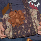 felt flower attached to a bag