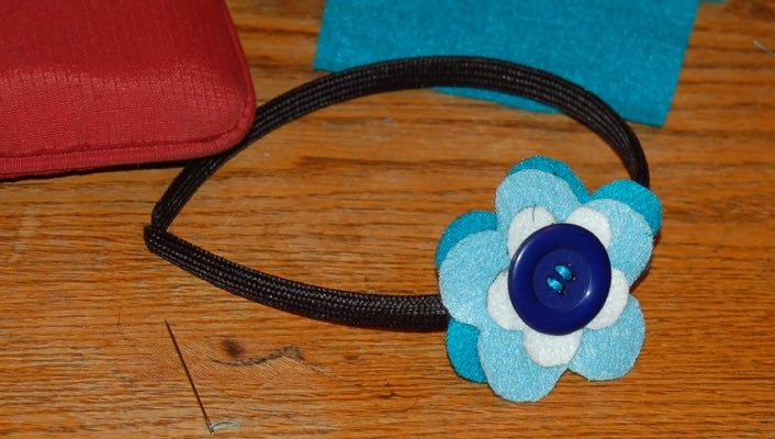 Felt flower shapes and button headband decoration made by a tween