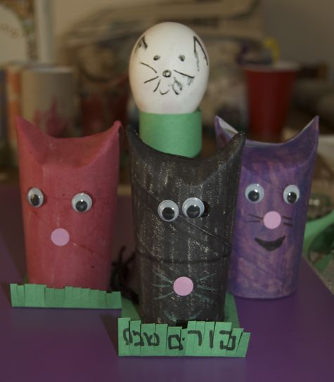 Toilet paper roll cats in red, black and purple for Mishloach Manot. One egg headed roll in the background.
