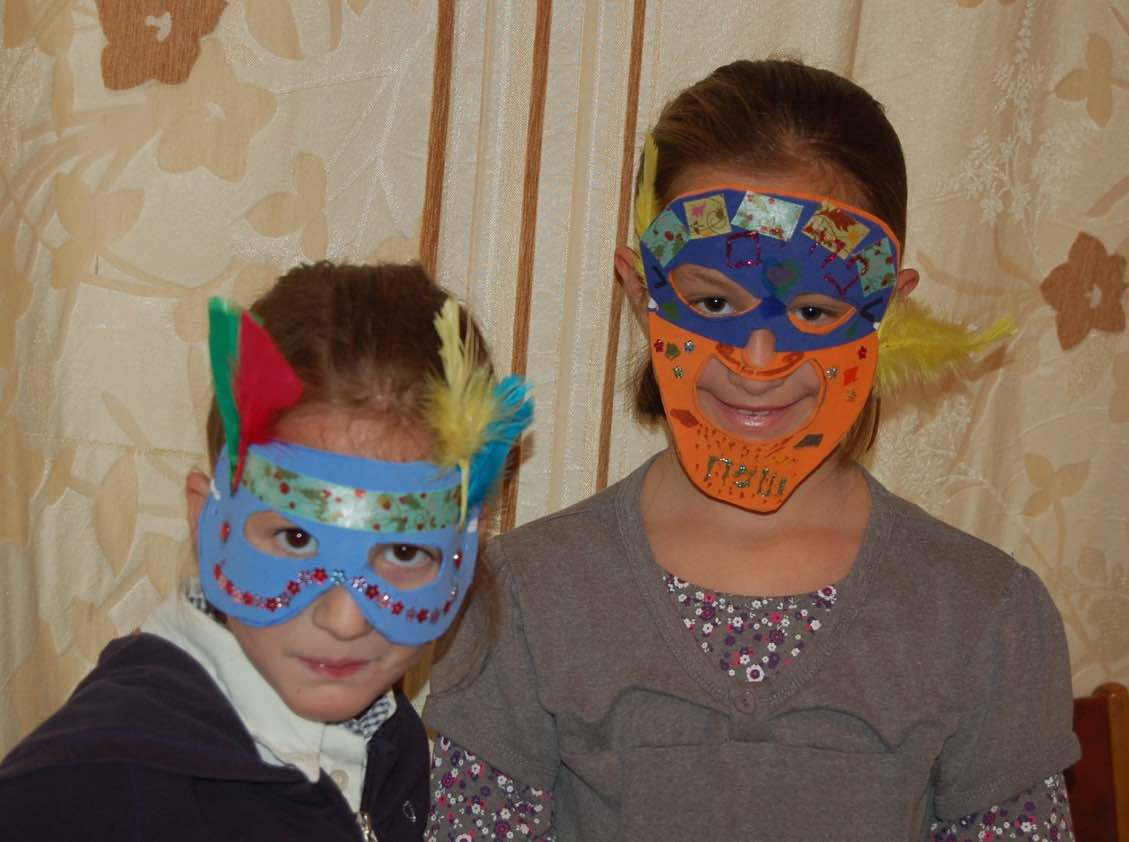 handmade masks modeled by two class members