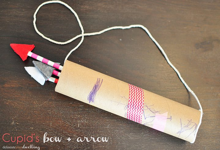 Bow and Arrow made from a paper towel roll and straws