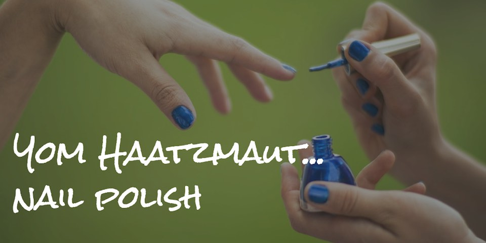 Applying blue nail polish as backdrop for text Yom Haatzmaut... nail polish