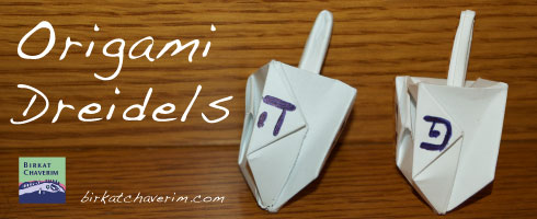 Photograph of two origami dreidels
