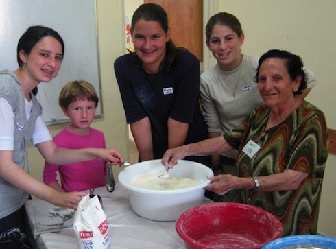 Melabev Bat Mitzvah program participants baking. Guest post about Melabev's bar and bat mitzvah program with participants of the day care center for elders with dementia. The program both teaches the children about chesed and gives them an opportunity to interact with their elders.Photo courtesy Melabev via birkat chaverim