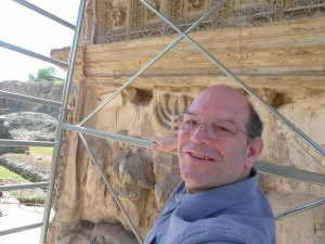 Dr. Steven Fine on site in Rome for the digitization project of the Menorah Panel on the Arch of Titus to determine the original colors of the menorah. via birkat chaverim. Images courtesy Professor Fine, Yeshiva University