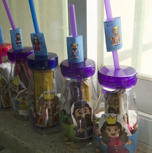 purim characters bottled Mishloach manot bottles with purim character cupcake wrappers and chocolate wrappers via birkat chaverim