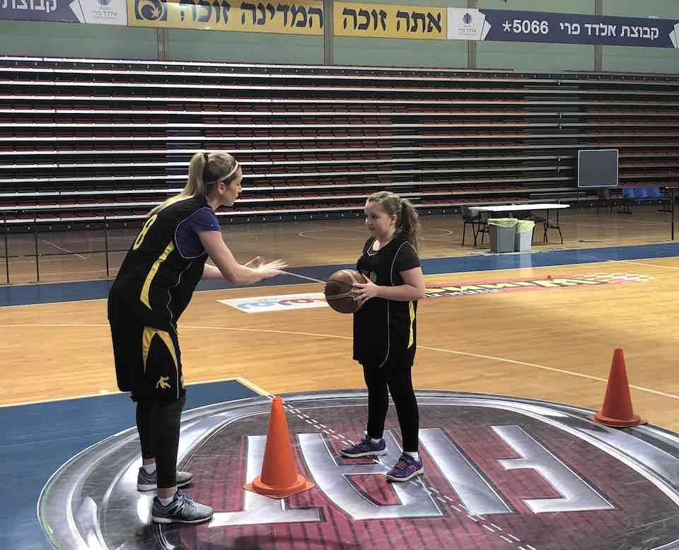 Bat Mitzvah enjoying one on one basketball during the Israel Sports Adventure