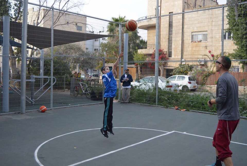 Bar Mitzvah shooting a basketball during the Israel Sports Experience