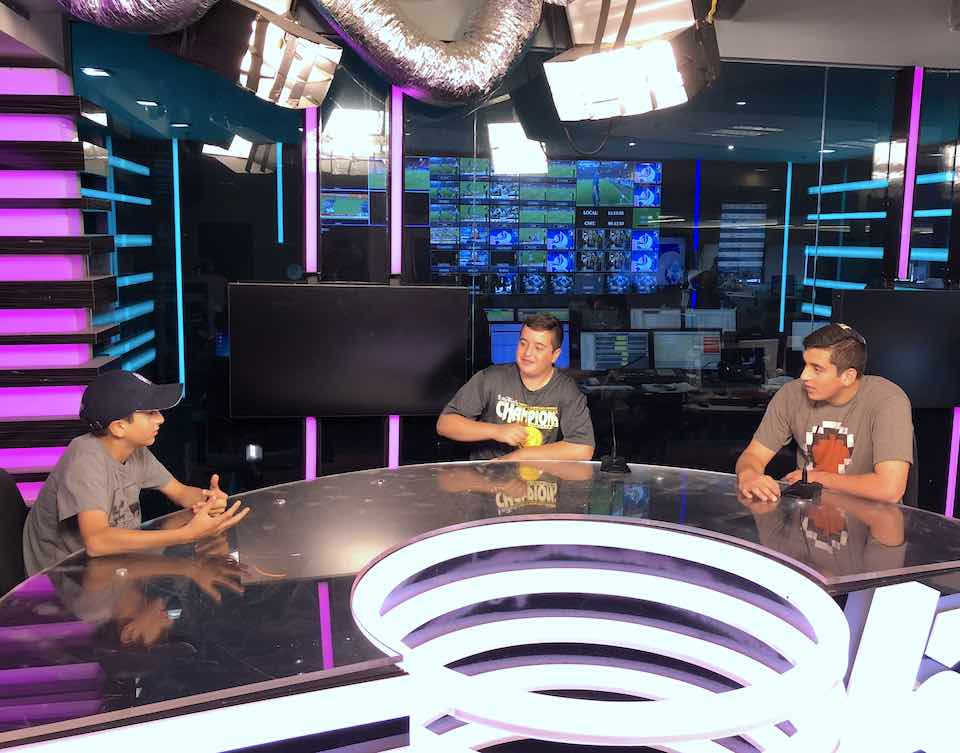 three young men behind the scenes at a sports studio during the Israel Sports Adventure