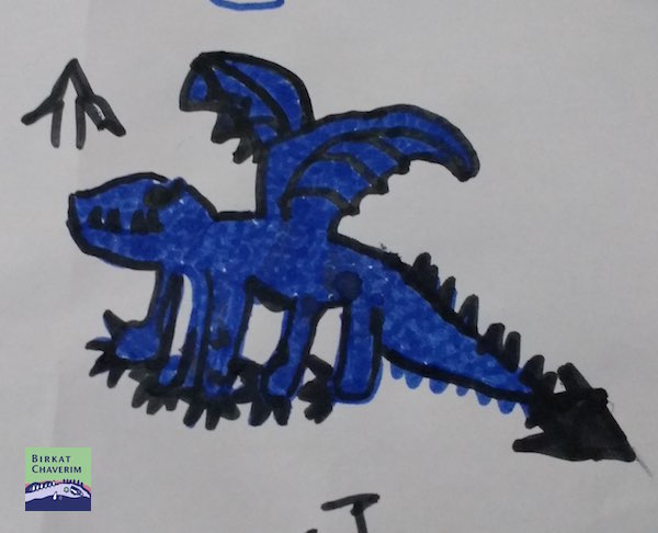 Detail of a drawing of a dragon used for key chains from shrink plastic