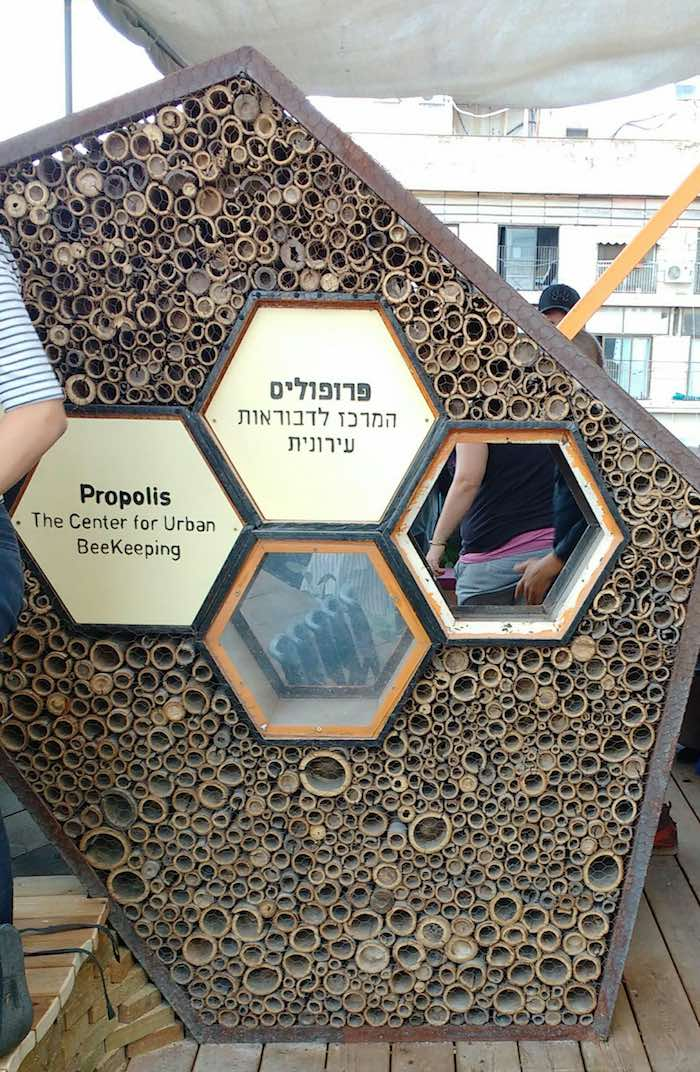 Propolis sign made of recycled materials including bamboo