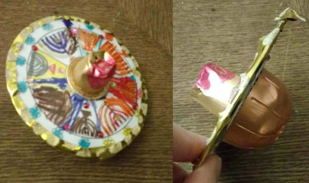 Dreidel made out of recycled materials including coffee pods.