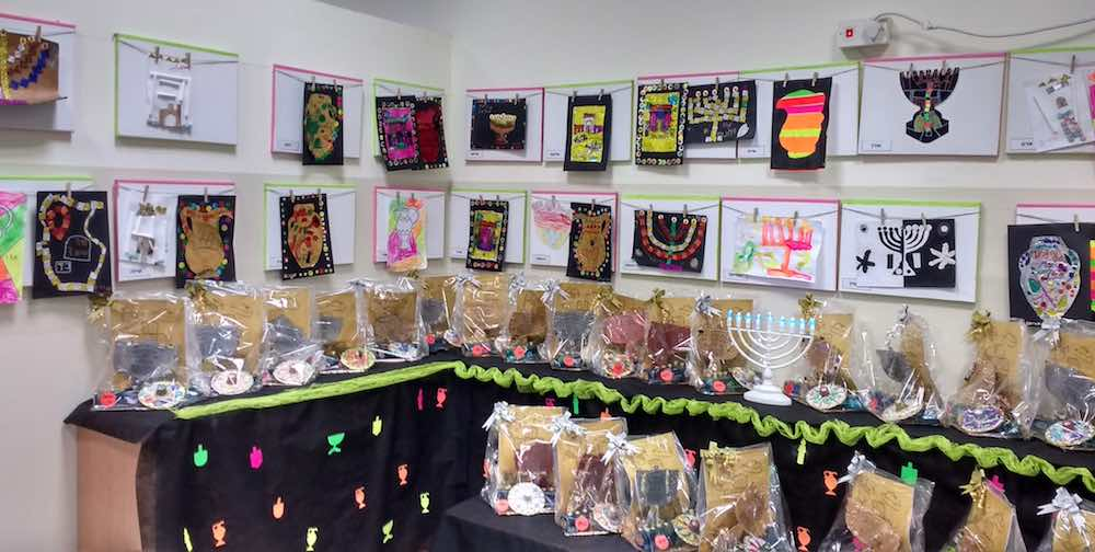 A variety of kid made designs for hanukkah lamps, temples, oil pitchers as well as your traditional dreidel and hanukkah lamp.