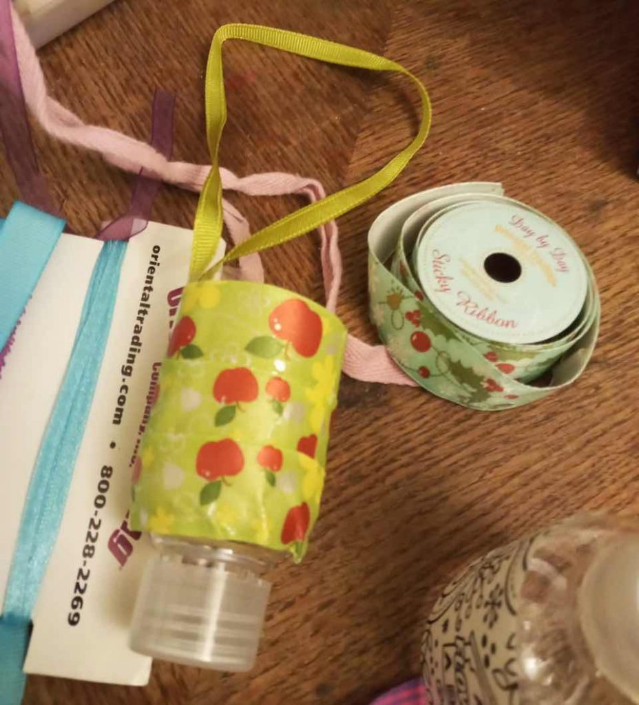 A hanging alcogel holder for a bag made by a preschooler